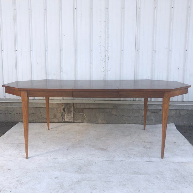 This stylish eight sided dining table easily expands from 64w-82w, offering versatile dining room or kitchen table...