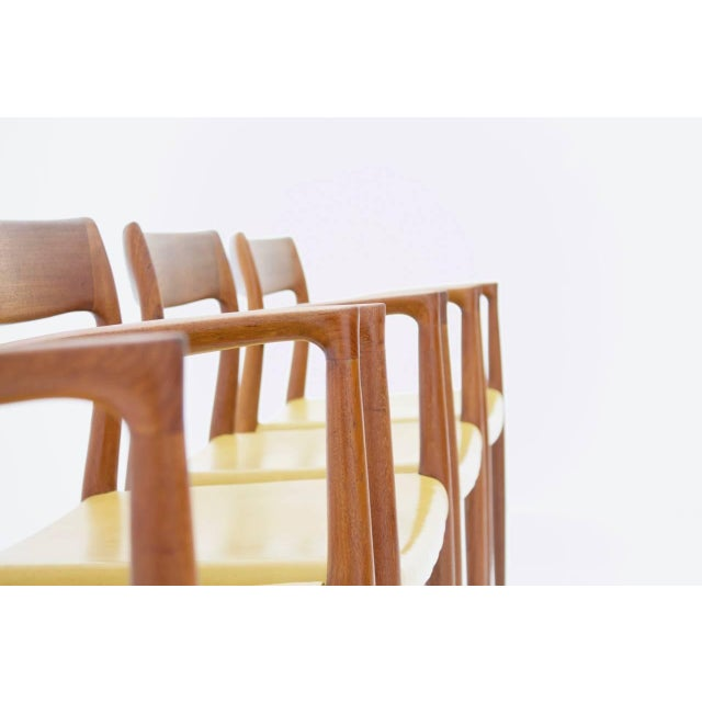 Nice set of four armchairs by Niels O. Møller model 57 in solid teak wood and ocher yellow colored leatherette. Measure: H...