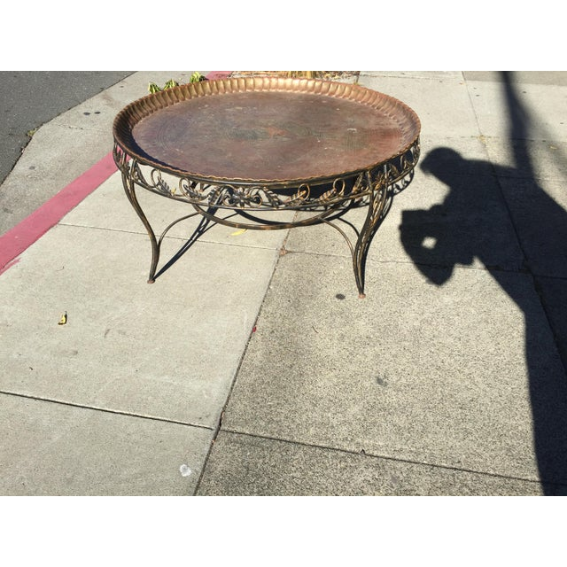 Round Brass tray table with Egyptian motif engraved on the tray, tray lifts off. This is in excellent condition, the tray...