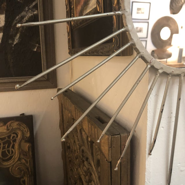 Mid-Century Modern Silver Starburst Mirror. Perfect wall addition to any modern or contemporary space that needs a little...
