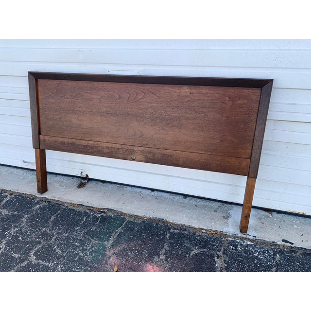 Vintage John Stuart Full/Queen head board. Comes with original bed frame. I believe the piece is walnut because matching...