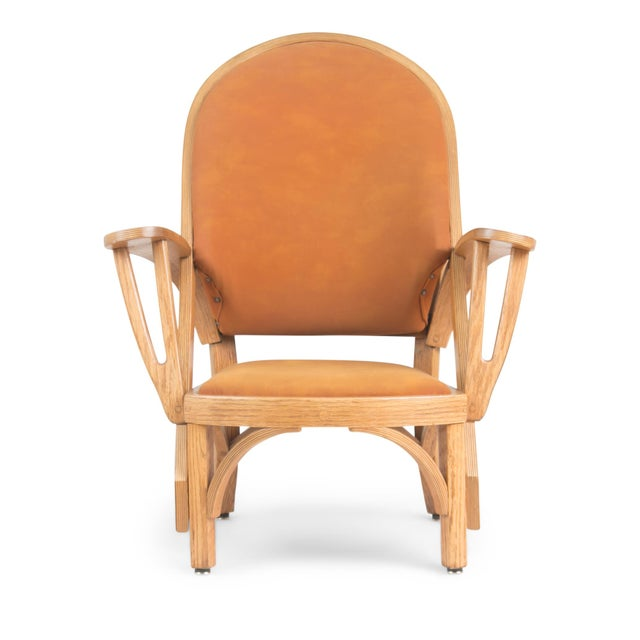 Pair of custom-made Norman Ridenour bentwood armchairs. This set of low lounge chairs feature sculptural bentwood frames...