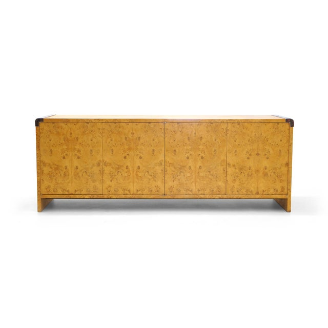 Milo Baughman for Thayer Coggin olive wood burl credenza or buffet with chrome accents on the top ends. Push open doors...