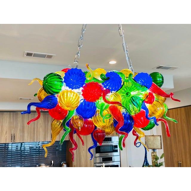 This custom-made hand/mouth blown Murano glass chandelier is made in the colorful Chihuly style. The rare horizontal...