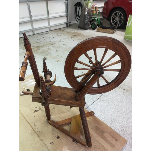 My parents loved collecting antiques. They came home with this Antique Spinning Wheel. It still even has cord on it's...