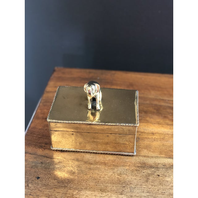 Lovely brass box topped with seated elephant sculpture.