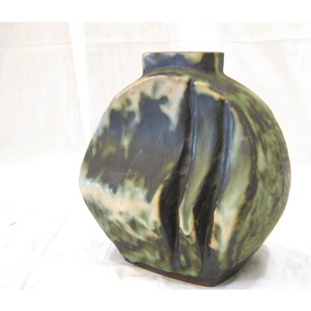 Sculptural ceramic vase from 20th century German artist Friedrich Schäffenacker. Round shape with dark green & black...