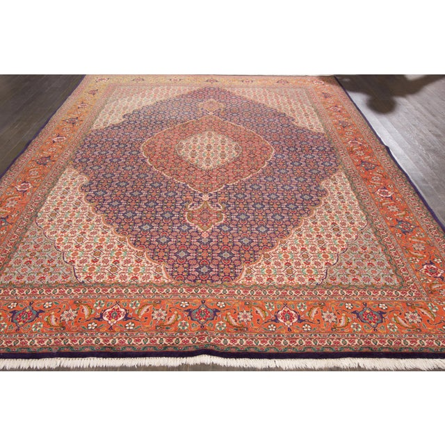 Vintage, hand-knotted Persian rug with a medallion design in multi-color. This rug has a fabulous color scheme and is...
