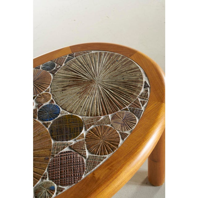 Charming tile top side table by Tue Poulsen for Haslev Denmark. Oak base with tile top in neutral and blue tones.