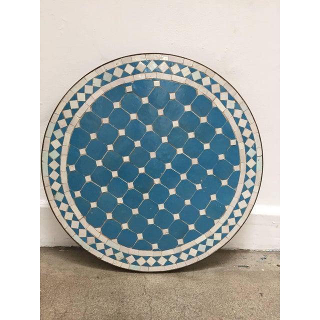 Moroccan mosaic turquoise blue tile side table on low iron base. Handmade by expert artisans in Fez, Morocco using...