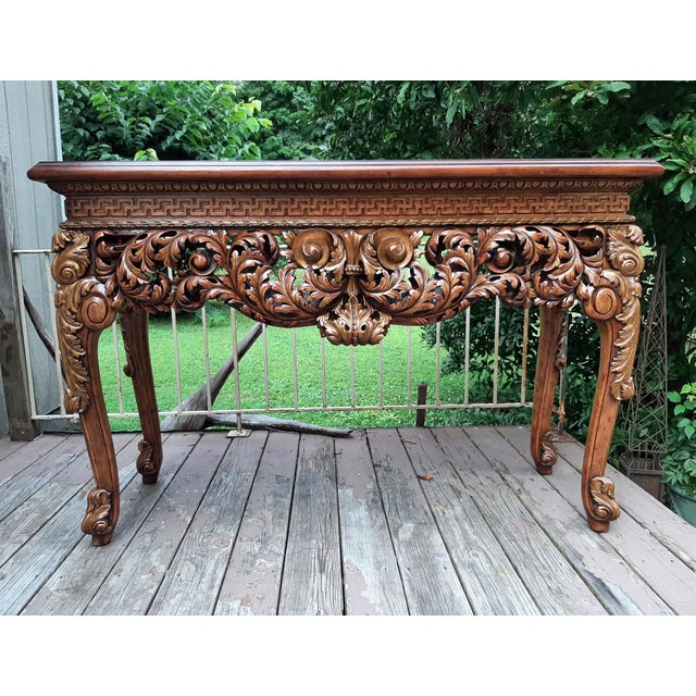 Item offered is a beautiful Theodore Alexander Althorp Living History Collection Carved Wood Console Table. The top is a...