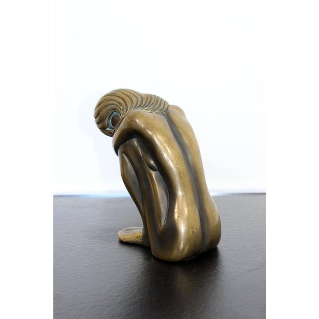 """For your consideration is a moving, bronze art table sculpture of a nude woman, entitled """"Solitude,"""" signed and numbered..."""