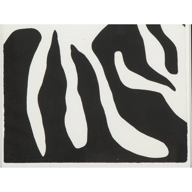 An abstract screen-print of a leaf form by William Turnbull (Scottish 1922-2012) in a black frame. We have a second print...