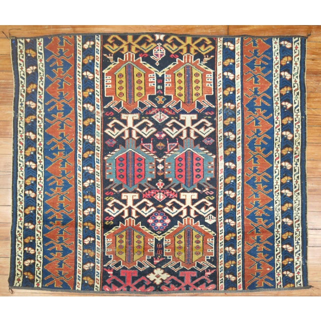 A late 19th century rug fragment in jewel tones. Would make for a super floor piece or can be uses as a throw piece too.