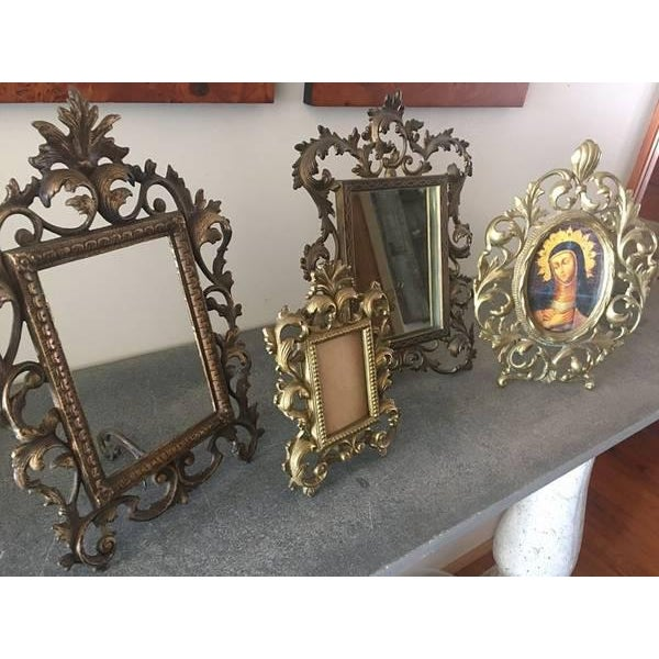 Collection of brass frames Assorted sizes range from 11.5 x 9.5 to 7.5 x 6.5. One has a mirror in it. Can use as frames,...