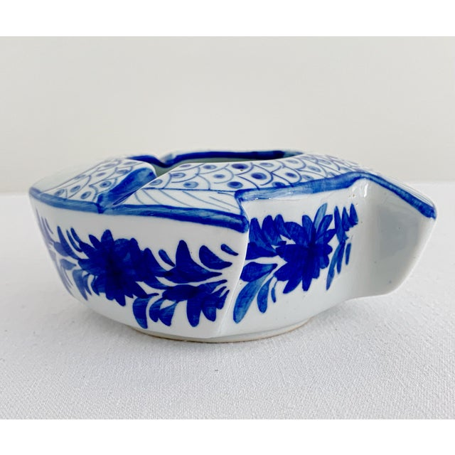 Vintage Chinoiserie white and blue hand painted porcelain ashtray in the shape of a fish. Very good conditions.