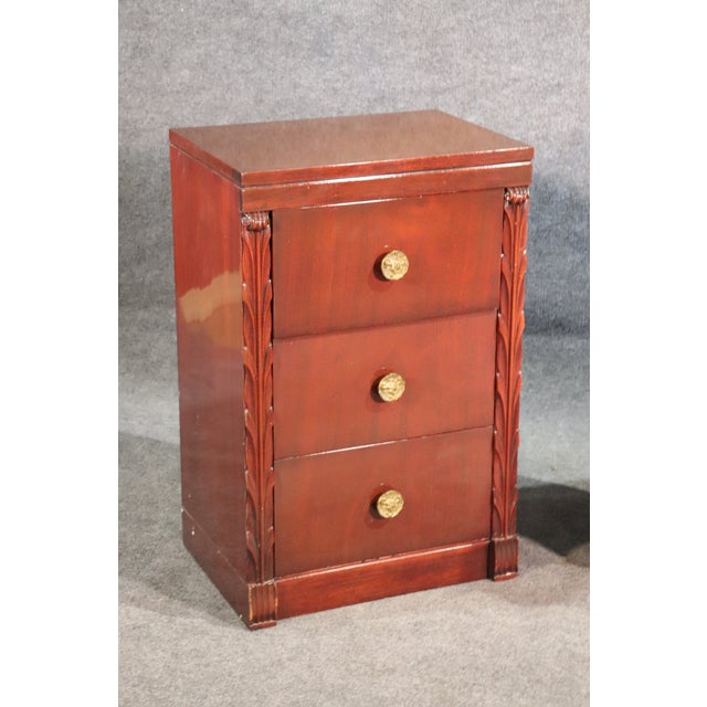 This is a nice pair of John Stuart nightstands in a red mahogany instead of a traditional brown mahogany, circa 1950. The...