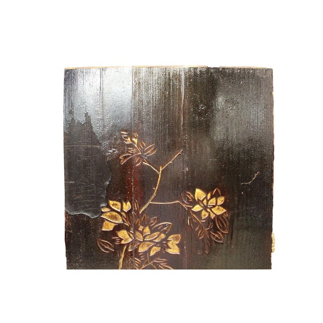 This is a restored wood decorative panel in dark brown base color. There is relief carving of oriental flower plant...