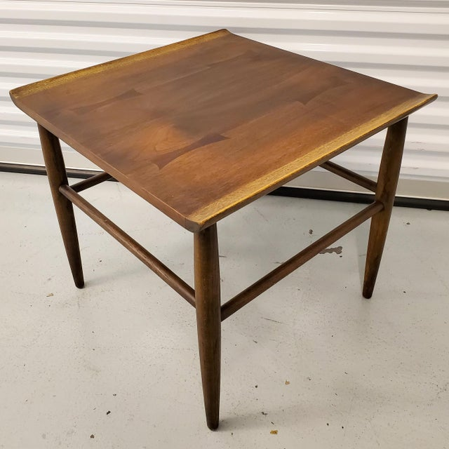 Mid century walnut side table with bowtie inlay and oak surfboard accents by Baumritter Furniture (Ethan Allen). In good...