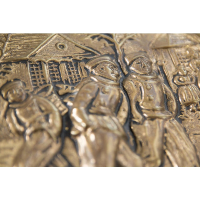 """A superb English hammered brass charger with winter scene and figures iceskating. Marked """"Made In England"""" on reverse...."""