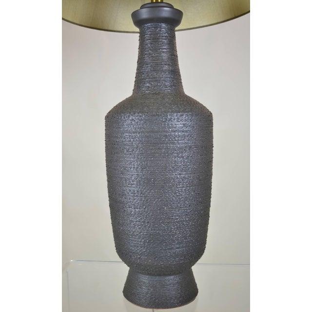 Hand thrown ceramic lamp in dramatic off black glaze, dark brownish black with wonderful texture. Original Shade in taupe...
