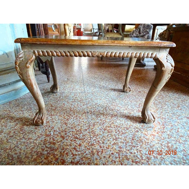 Fabulous Italian coffee table or accent table . Polychrome painted and carved wood with cabriole legs ending in ball and...