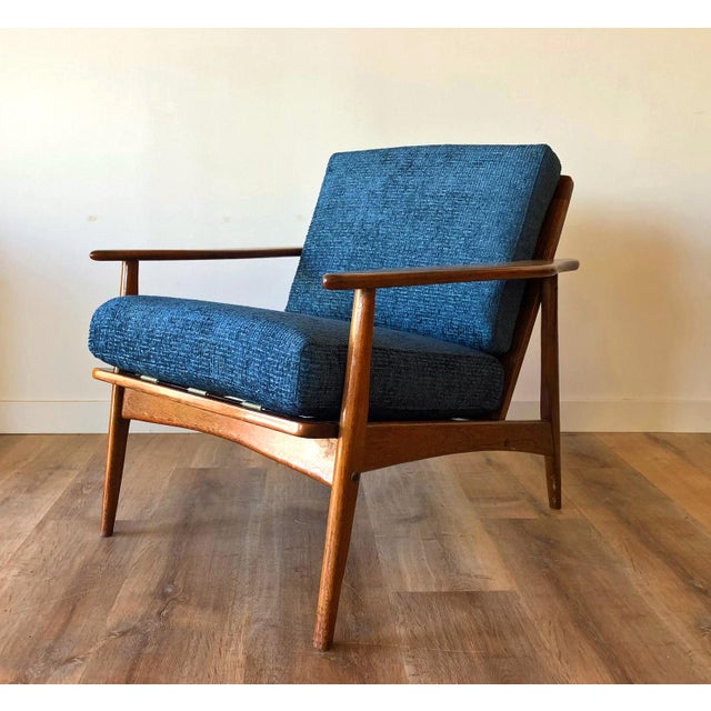 Walnut mid-century arm chair with new upholstery and cushions. Refreshed gloss finish.