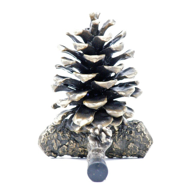 This beautiful, fully open, mid-size, solid bronze Ponderosa pine cone is cast on a short pine branch and secured to the...