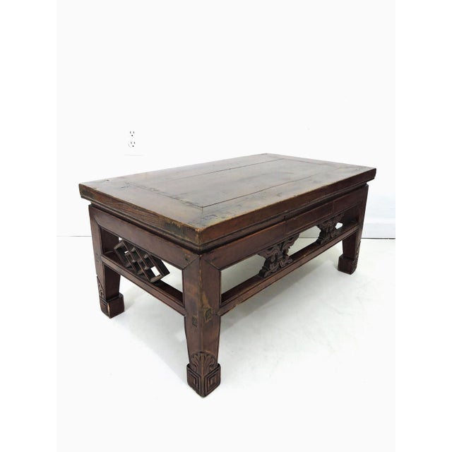 Antique Chinese opium bed table that has great age to it, and fantastic wood patination and colouration. The one side has...