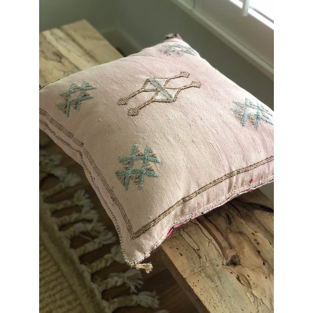Perfect pale pink with aqua stitching, approximately 18 x 18.