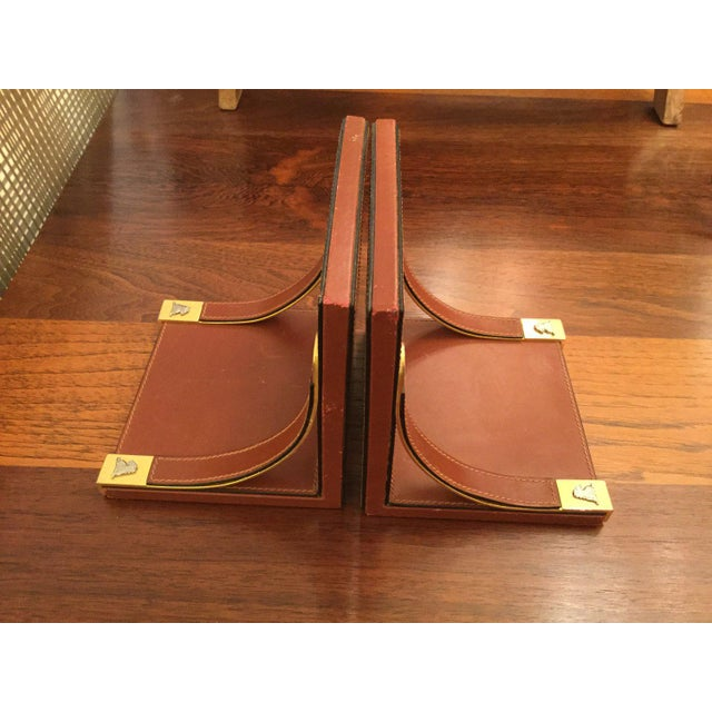 Leather and brass bookends. Made in Italy.