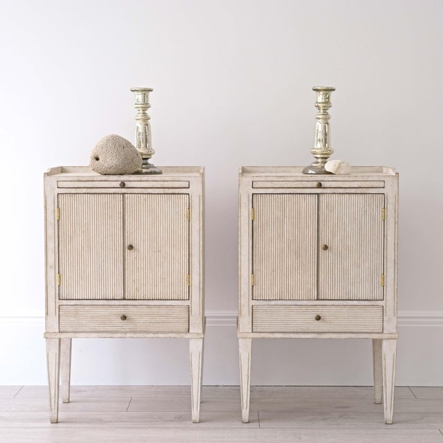 A pair of very fine bespoke Gustavian style 'Lotta' bedside cabinets hand crafted in Sweden and featuring; galleried tops...