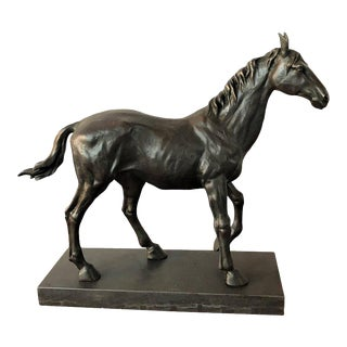 A Bronze Long Earred Stallion