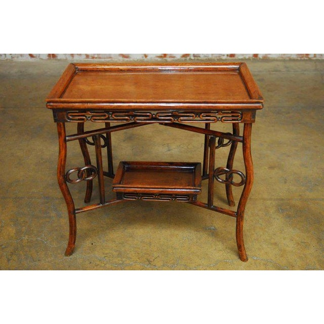 Elegant Chinese Qing carved rosewood folding tray table featuring a lower removable tray. Rectangular tray top with a...