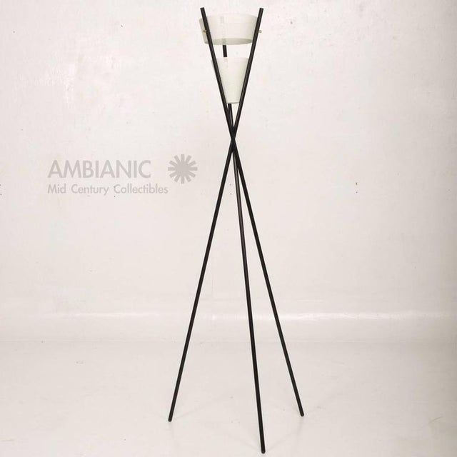 AMBIANIC is please to offer for you a single floor lamp with tripod base in black finish with perforated metal shades...