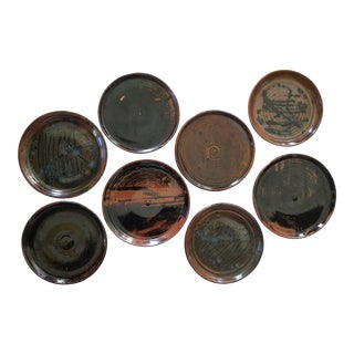 Black and Brown Glazed Pottery Plates - Set of 8 For Sale