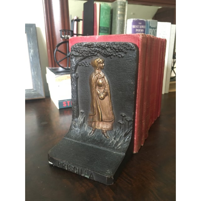 Heavy cast iron bookend pair featuring pilgrims John and Priscilla Mullins Alden. John Alden is traditionally held to be...