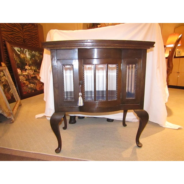 With curved beveled glass, a serving tray mounted atop and amazing appeal, this old Chocolate Display Table makes for a...