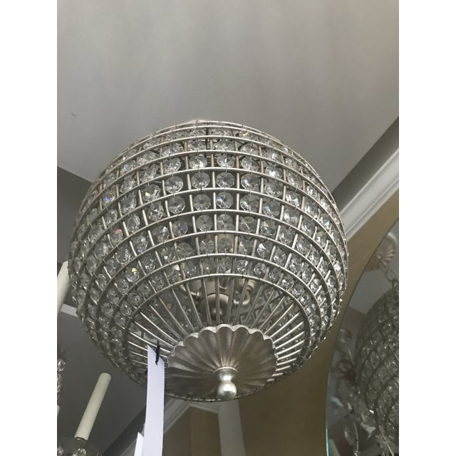 The Visual Comfort Renwick Pendant presents an orb of faceted crystals that sparkle and shine with a classic aesthetic....