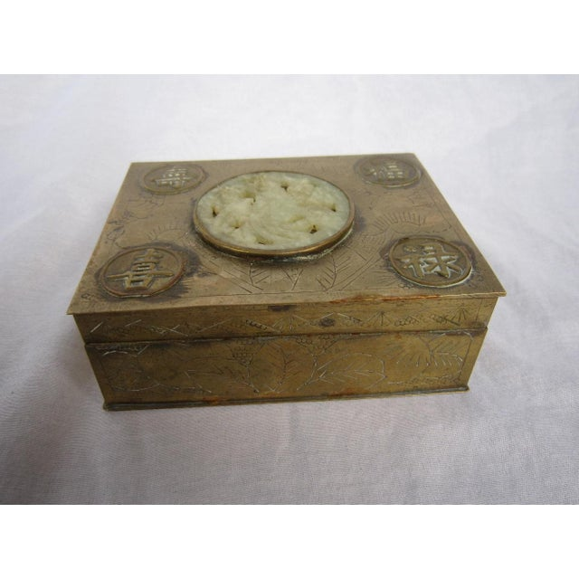 Sweet chinese brass box inset with carved jadeite medallion. Wood lined, it's a wonderful little catchall of a box....