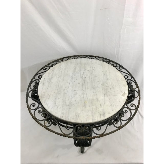 I love black paired with white! This wrought iron 1940s French marble and wrought iron coffee table fits the bill. I can...