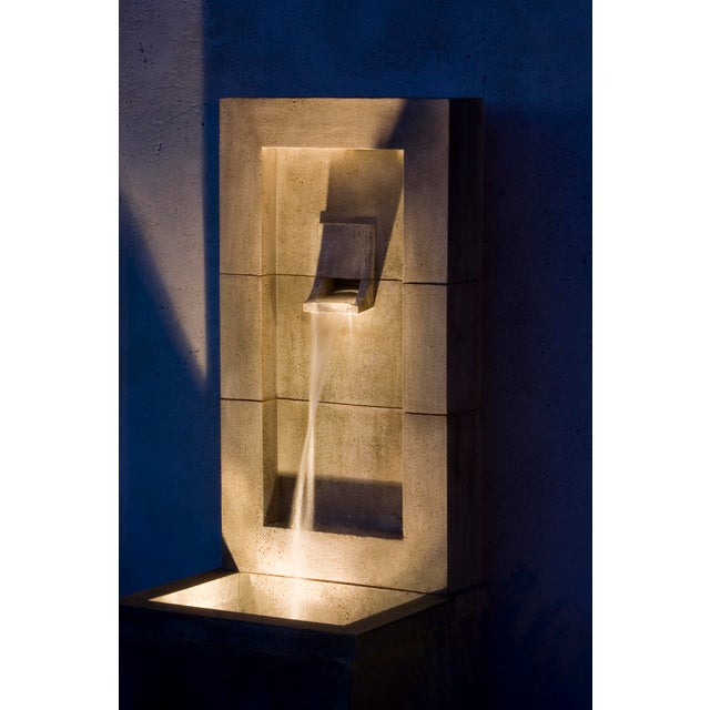 A wall fountain with clean lines in a Greystone finish. The pump kit for this fountain includes a submersible LED light...