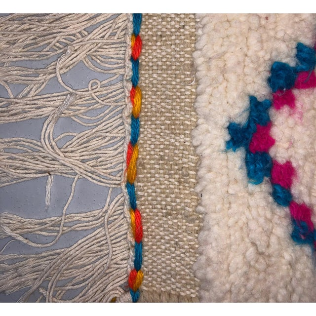 This wool rug was handmade in Morocco and displays a multicolor pattern, in the shape of diamonds. It is very thick and...