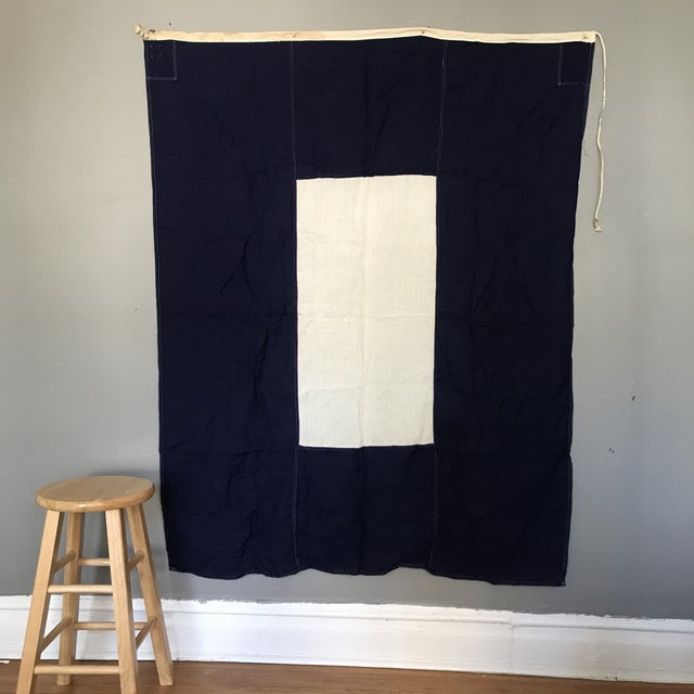 """The navy and white concentric rectangles of this maritime flag """"P Papa"""" is used internationally at sea to signal """"about to..."""