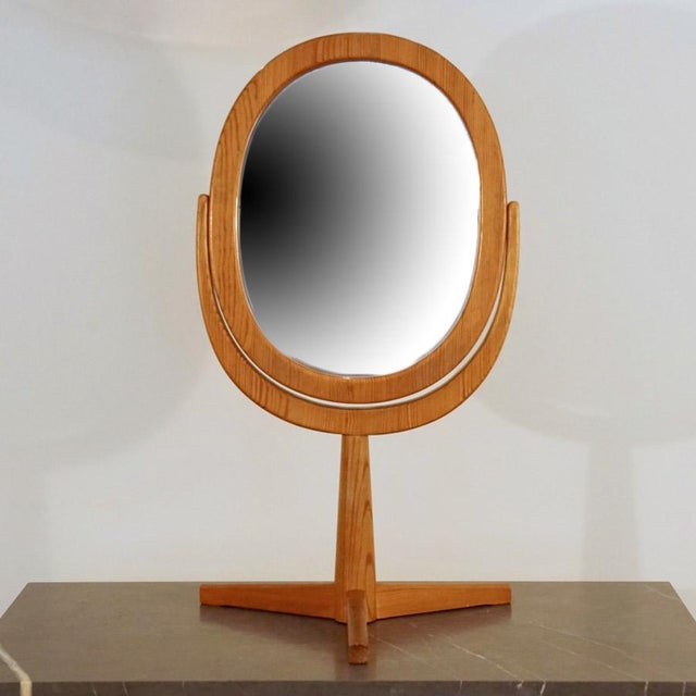 This is a 1960s Hans Agne Jakobsson for Illums Bolighus Table Mirror. Hand made Douglas Fir adjustable table top mirror.