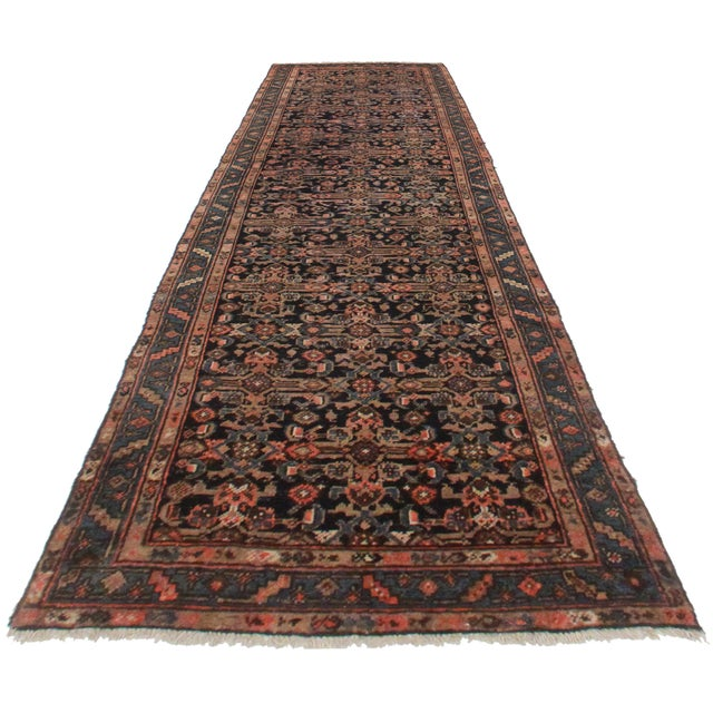 Here is a vintage Persian Mahal runner rug. Hand-knotted from wool. Features a lovely geometric design and rich, bold colors.