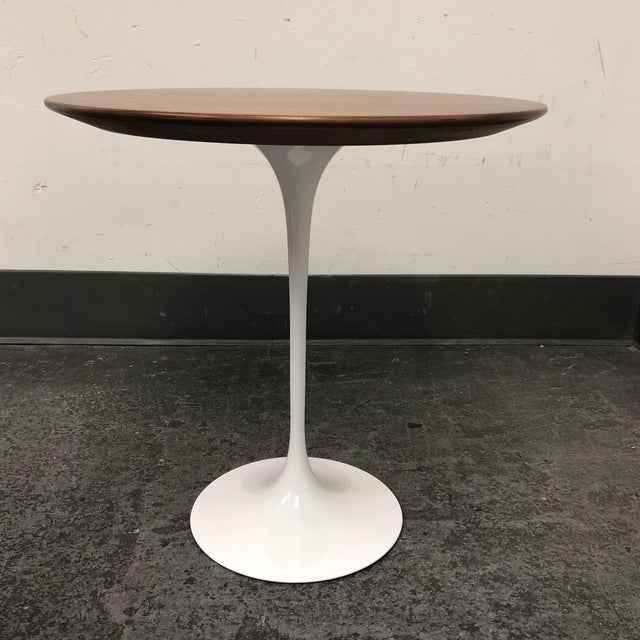 design plus gallery presents a saarinen side table by knoll the round surface is a