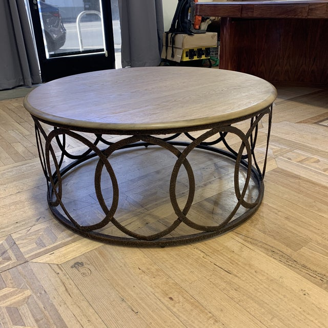 Design Plus Gallery presents a Layla Grace Round Metal Coffee Table. Oak top has a gray wash and makes for a taupe tone....