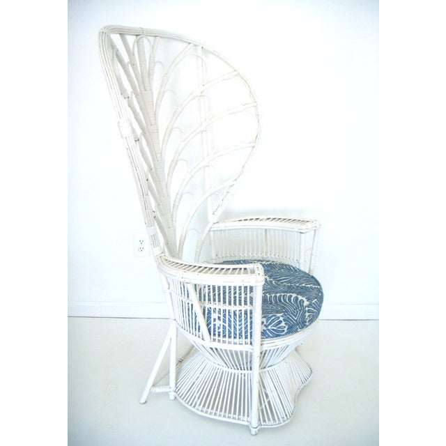 On final sale - a vintage white peacock or fan back chair with original white paint. The chair is made from cane, which is...