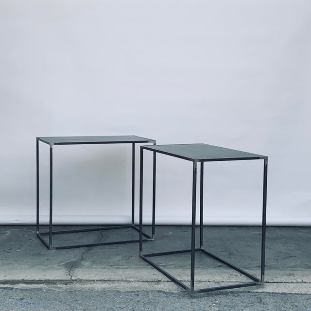 Pair of tall 'Filiforme' patinated steel plate side or occasional tables by Design Frères. Inspired by the Wabi-Sabi...